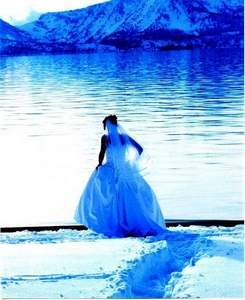 Sherry McManus / Associates in Photography / A bride is photographed in front of the icy waters of Lake Tahoe.
